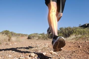 Highlighted leg bones of jogging man