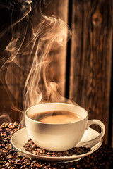 Aroma cup of coffee with roasted grains