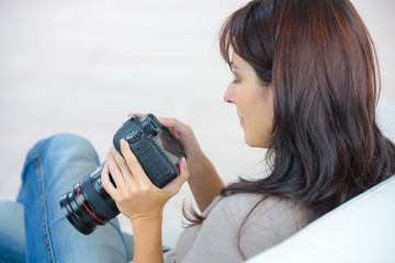 Woman holding an expensive camera