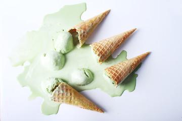 green tea ice cream cones dropped upside down