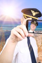 Pilot doing selfie in summer vacation spot