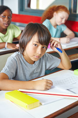 Pensive Japanese child in class