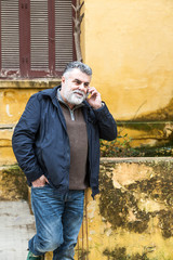 Attractive bearded man talking on phone