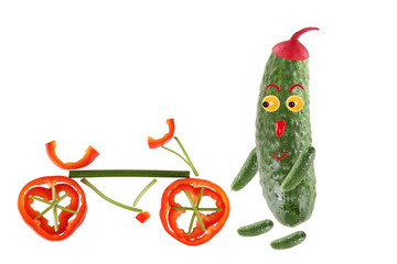 Little funny cucumber standing with bicycle. The picture is made