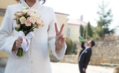 happy bride, groom sad concept