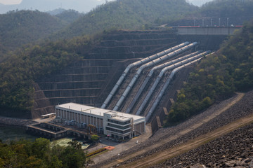Great dam to generate electricity in the misty valley