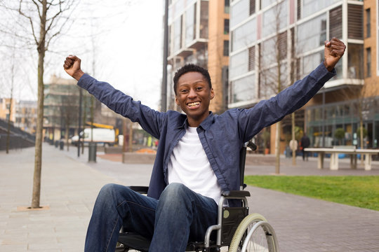 happy wheelchair user celebrating a success.
