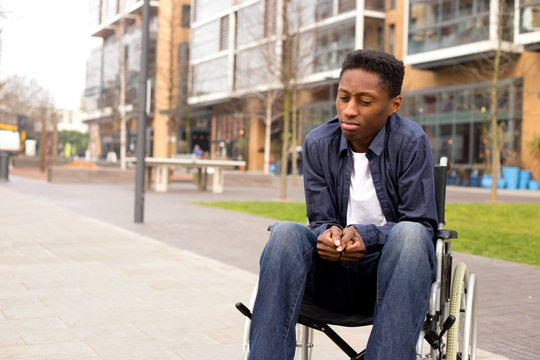 a young wheelchair user looking worried.