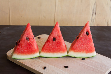 red watermelon on the wooden brackground