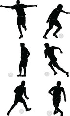 Soccer players in silhouettes