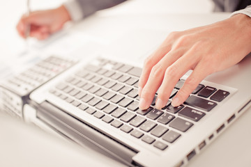 Closeup of businessman hands typing on laptop computer