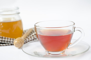a cup of tea with honey on white background. healty food