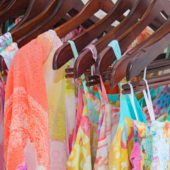 Summer beautiful clothes hanging in the store