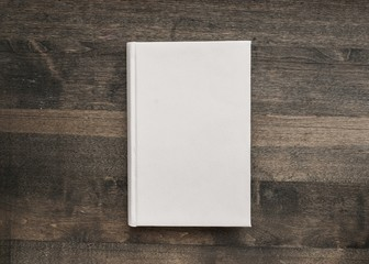 Book. Photo blank book cover on textured wood background