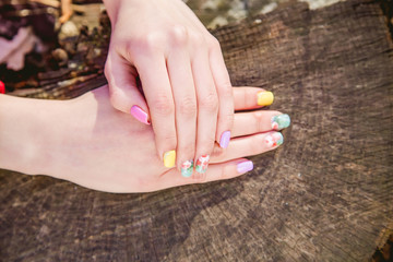 manicure on a background of cut wood