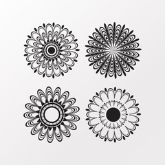 Collection of four polyensian flower designs