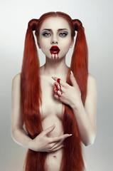 Beautiful redhead bleeding woman