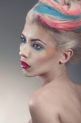 Beauty portrait with creative coloured hair-style