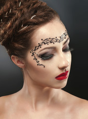 Beauty portrait with face-art