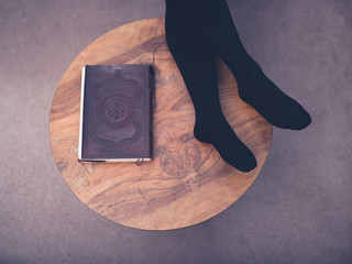 Woman resting her feet on coffee table
