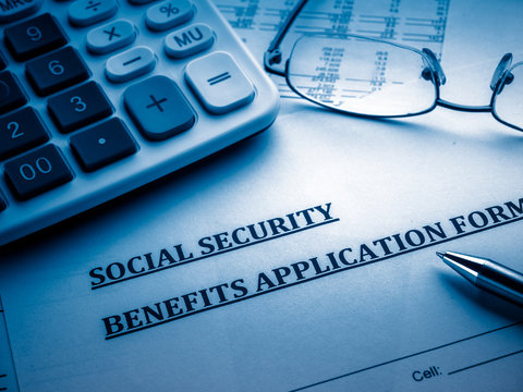 social security benefits application form on the desk.