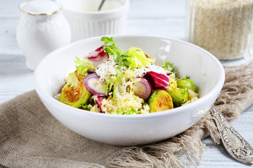 Cous-cous with cabbage and sour cream