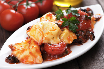 Tortellini pasta with tomato and olive sauce