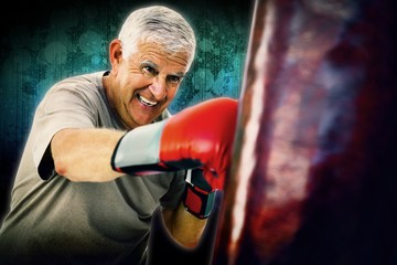 Composite image of portrait of a determined senior boxer
