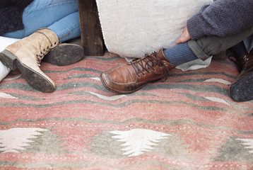 An apple orchard in Utah. Detail of feet of two people sitting on a blanket.