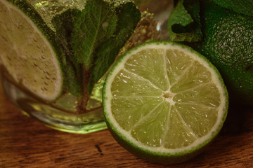 Mojito cocktail with fresh lime on wood table