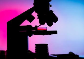 Silhouette of a laboratory microscope