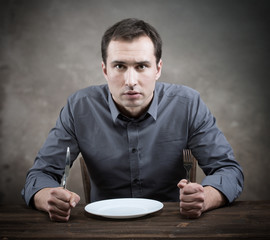 Hungry man. Slow restaurant service concept