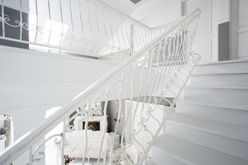 White stairway inside expensive house