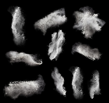Abstract design of white powder cloud against black
