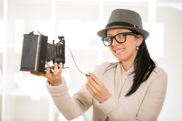Woman with retro film camera