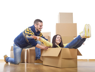 Couple riding in a cardboard box