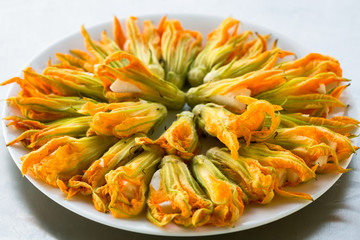 Zucchini flowers stuffed with cheese prepared to fry