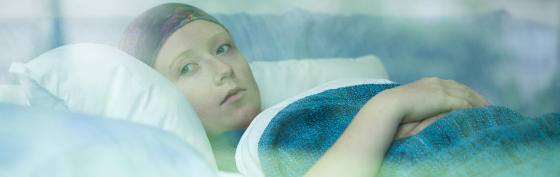 Young woman suffering from cancer