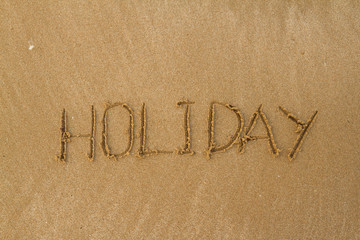 Happy Holidays Message on Beach
