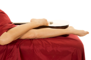 woman legs with red sheet lay out by guitar
