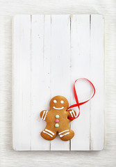 Image of Gingerbread man on white vintage cutting board