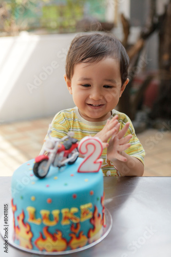 Happy Asian Toddler Boy With His Birthday Cake Outdoors
