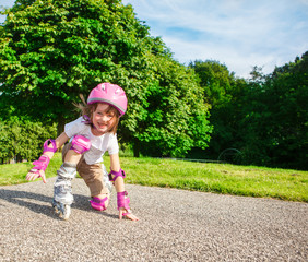 Kid in pink protective sportswear