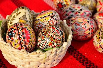Decorated Easter eggs in a basket.