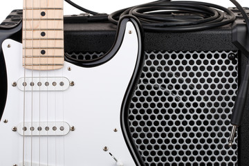 Guitar with amplifier and audio cord with jack closeup