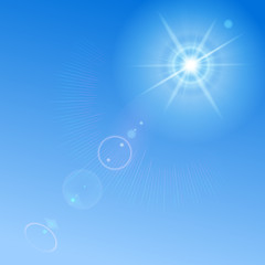 Background with blue sky, sun and lens flare