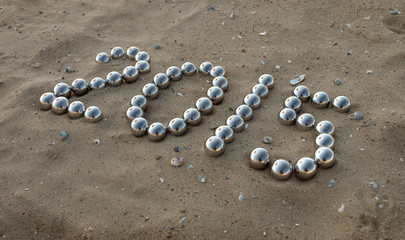 number 2015 on the sand