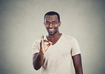 Portrait happy handsome man giving ok hand sign