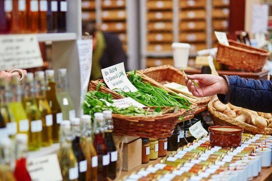 Man buying fresh leek on market