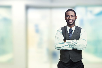 Portrait of a young smiling businessman standing in office